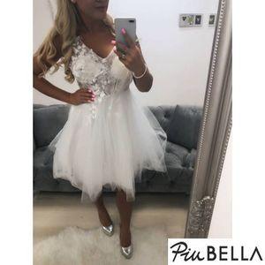 Reina White - Tüllszoknyás ruha virágos felsőrésszel kép